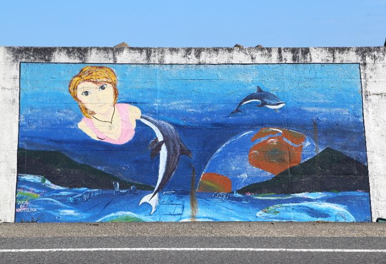 イルカと女性を描いた1000人画廊の作品